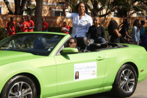 Yvette Colbourne Campaigning On Convertible Car